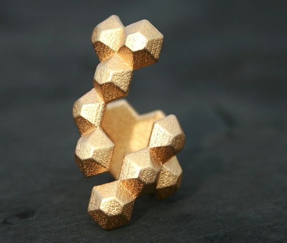 This 3-D printed gold ring reminds us of honeycomb.
