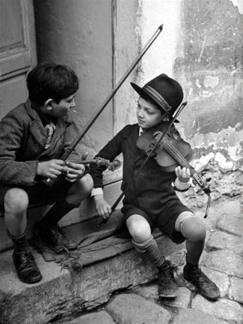 gypsy children playing violin in street, Budapest, Hungary, 1939 / N.R. Farbman