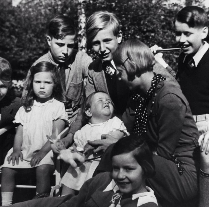 Helga Goebbels (looking less than thrilled) & Hilde Goebbels playing in their garden with brother Harald Quandt and his friends. 1935.