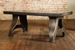 Item #: TA-4588   Antique Industrial Coffee Table.  These original table legs were manufactured between 1875-1912 and by the F. E Reed Co.  The newer table top bought new life to the legs while adding a new function as a center table or coffee table instead of the original use as a machinists' lathe from one of the largest makers in the world.