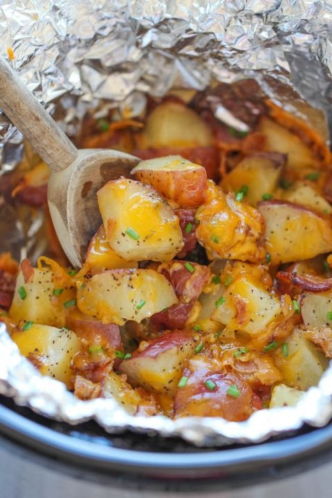 Slow Cooker Cheesy Bacon Ranch Potatoes - The easiest potatoes you can make. I've made this and added cooked chicken to mine.