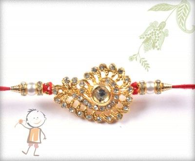 buy online rakhi - #Designer #Diamond #Traditional #Rakhi, Traditional Pendent Diamond Rakhi, surprise your loved ones with roli chawal, chocolates and a greeting card as it is also a part of our package and that too without any extra charges. http://www.bablarakhi.com/