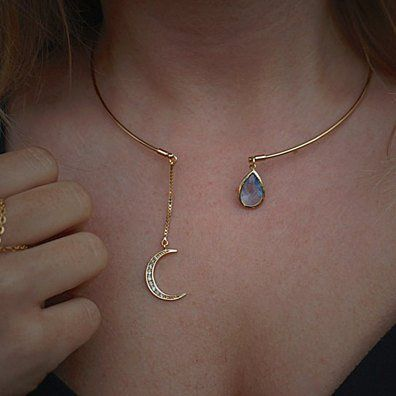 This amazing, open ended collar bone necklace: -Thin, 16K gold-plated tubing (lead/nickel free) - on one end, a gorgeous 16k gold-plated moon crescent encrusted with tiny sparkling crystal that hangs from a tiny 1.5 inch box chain -a gorgeous faceted glass sky blue drop, framed in 16K plating  easy to take on and off and lays nicely on neck.