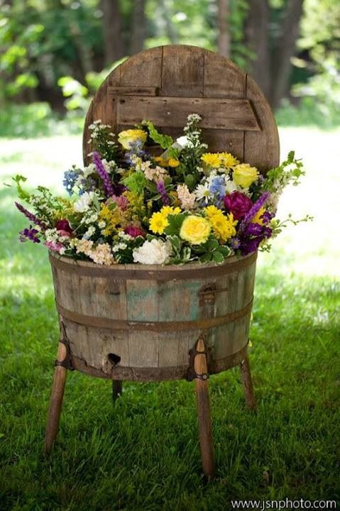 using wooden barrel as flower bed,looks like an old washing machine:) yes www.plantamemory.com