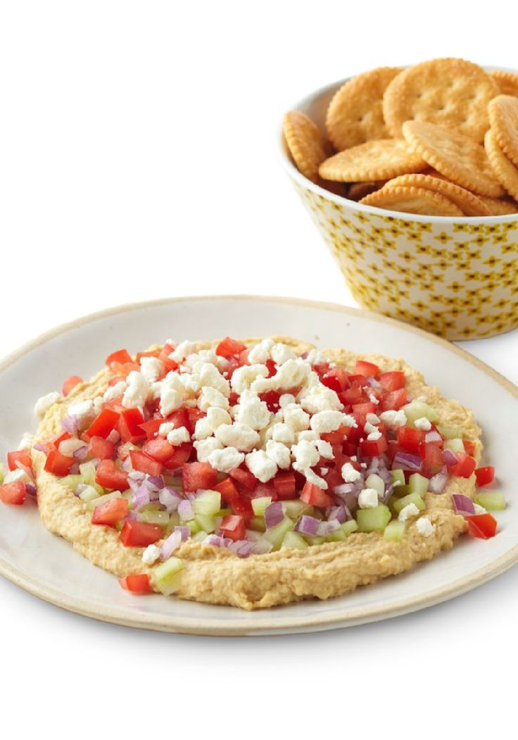 Chunky Vegetable Hummus Spread – Hummus is a nice spread all on its own—but tastes even better with chopped cucumbers, red onions, plum tomatoes, and a sprinkle of crumbled feta cheese. This is one Healthy Living appetizer recipe you'll want to save!