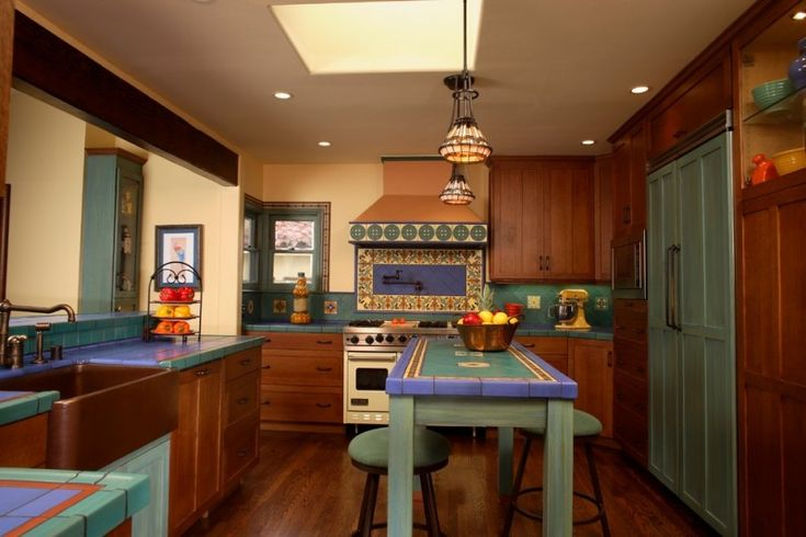 good colors for kitchens recessed panel cabinets tile countertops multicolored backsplash paneled appliances farmhouse sink table stools pendants ceiling lights hardwood floors mediterranean design of Stunningly Good Colors for Kitchens to Use in Your Kitchen