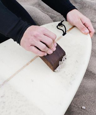 A functional and elegant surf accessory cut and crafted from American Walnut