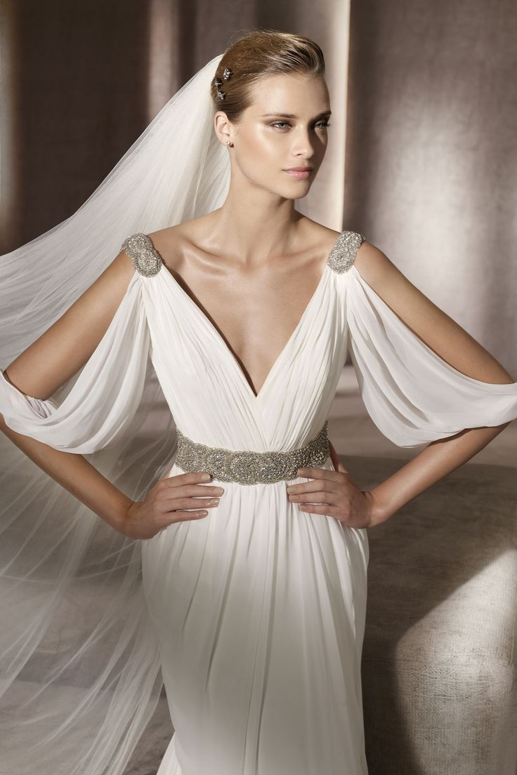 Lovely gown...If i were to have a destination wedding I'd wear this.