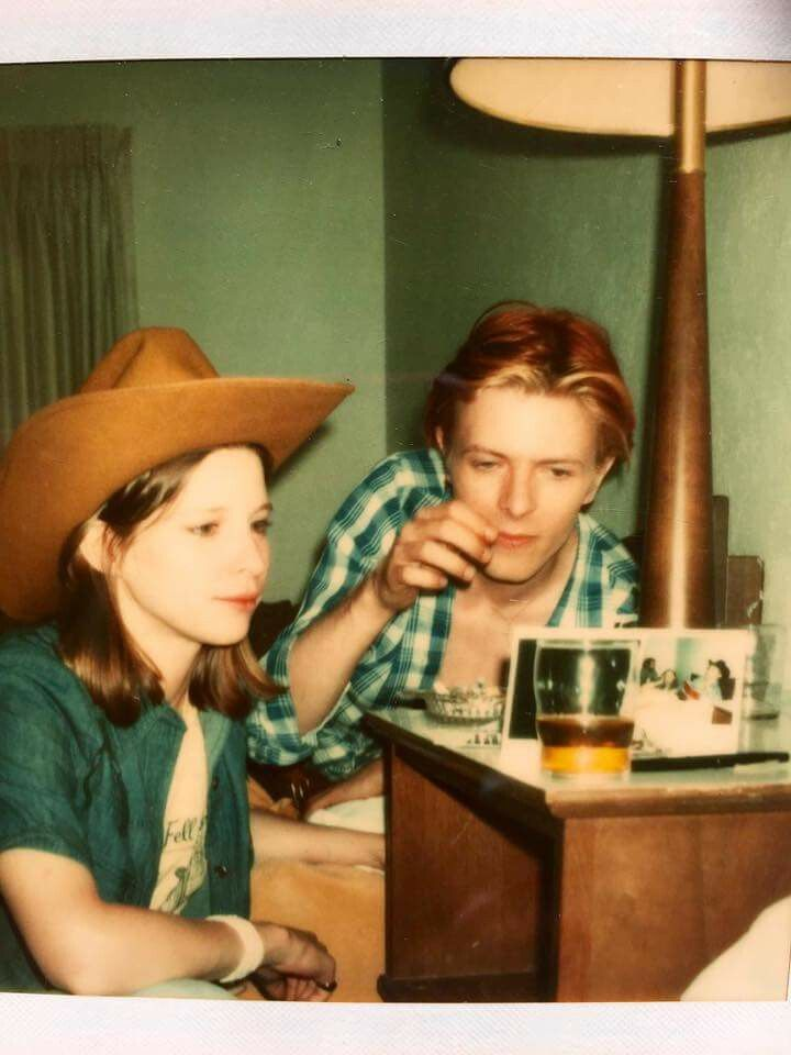 David Bowie and Candy Clark looking at Polaroids back from The Man Who Fell To Earth. Picture from Candy Clark's personal collection.