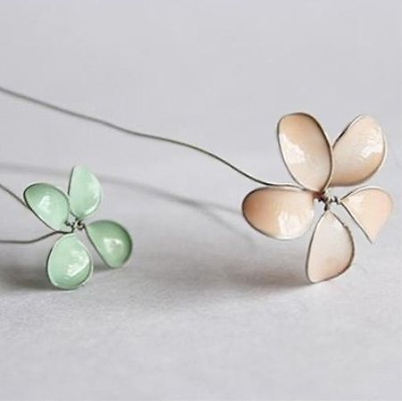 Hard to believe that this delicate flowers are made of wire and nail polish. Jewellers wire is wrapped to create the shape of the flowers an...