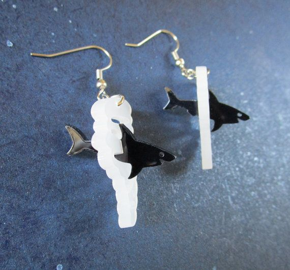 Get ready to make your own style with these truly one of a kind, hand made and personally designed Original 3D Shark-tornado Dangle Earrings inspired by the Sharknado Movies! Time to blow them all away with this amazing and dangerous style!  A wicked cool 3D design with nickle-free hook and jump ring, and laser cut Tornado and Shark from white and black acrylic. Measures 1.25 long and about 1 wide.  Allergy to metal? All earring styles can be made with hypoallergenic plastic hooks or even…