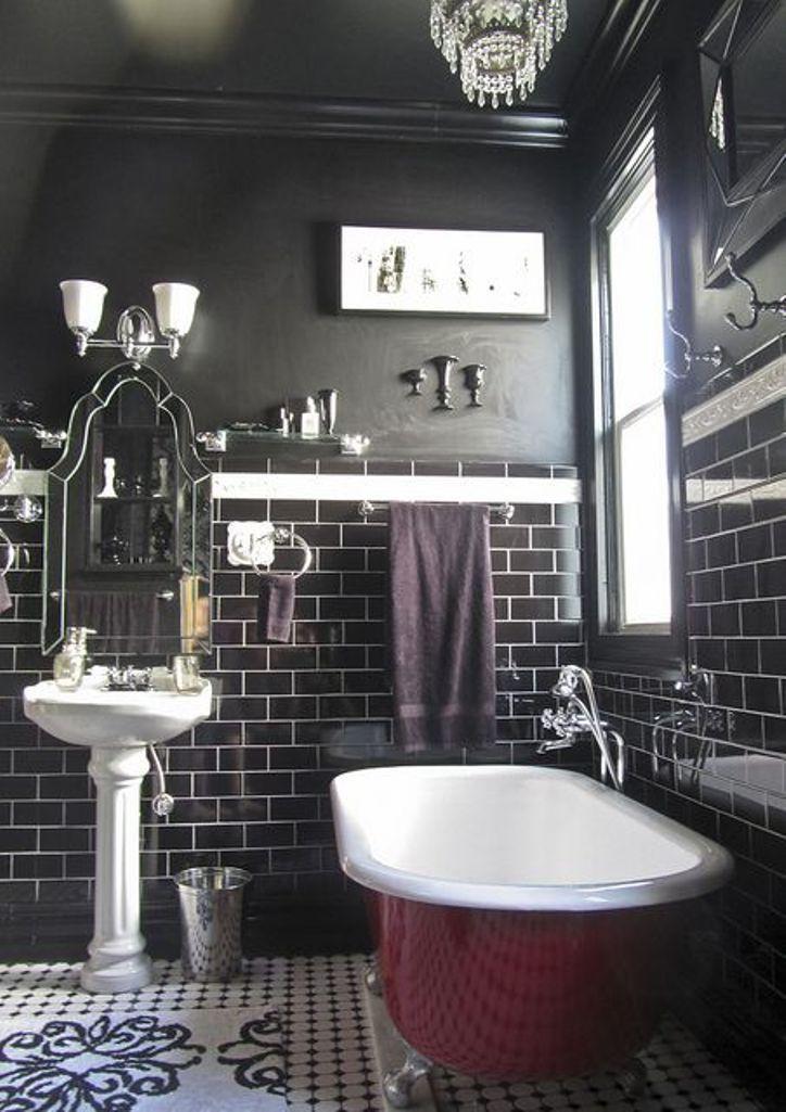 Black bathroom with dark cherry red clawfoot tub