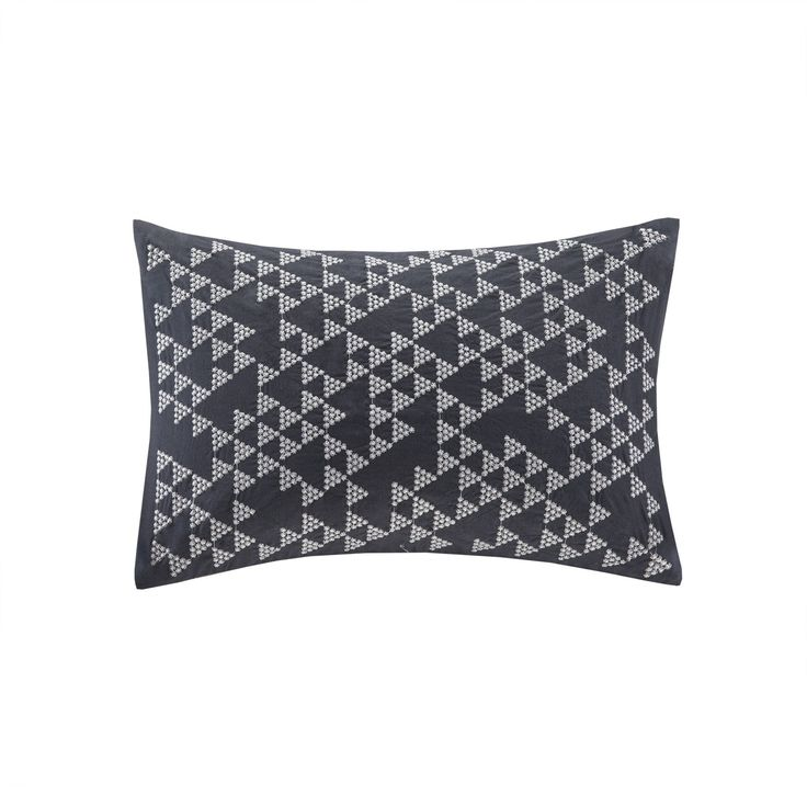 Add a little shine to your room with the INK+IVY Thea Oblong Pillow. This navy blue base provides a modern update with metallic silver embroidery in a geometric pattern.