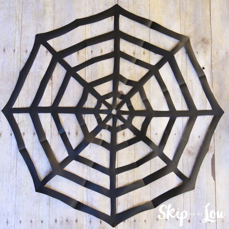 easy tutorial on how to make a paper spider web by cutting and folding paper a kirigami spider web the perfect halloween decoration