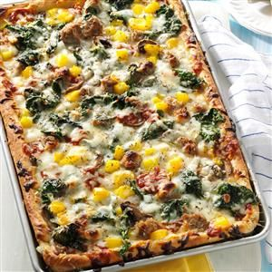Pepper Sausage Pizza Recipe -Fresh spinach gives this recipe from our Test Kitchen a tasty twist. That leafy green plus yellow peppers, snow-white mushrooms and tomato sauce make this a colorful addition to you pizza buffet table.—Taste of Home Test Kitchen