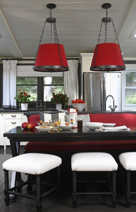 <3The impact of two large scarlet lampshades and a long, red banquette is intensified by the lack of color elsewhere ~The result is a white kitchen that exhudes elegance, with an eye-catching punch of color....
