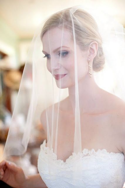 classy red lip makeup on a bride