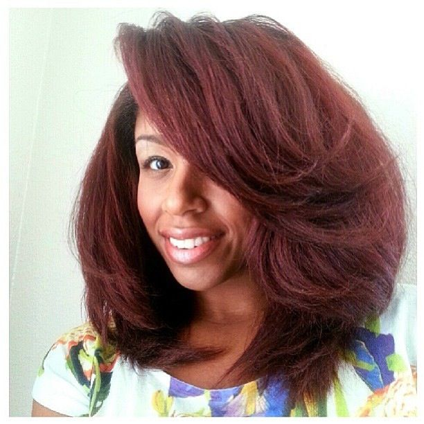 Voluminous natural hair blow out