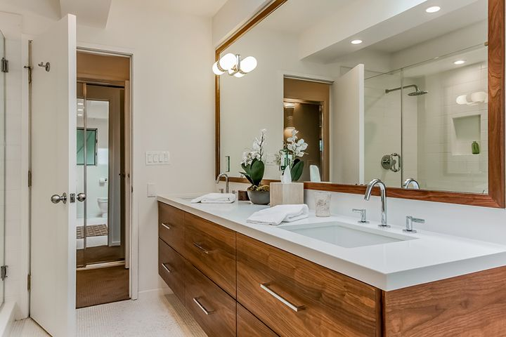 Mid Century Modern Bathroom with Caesar Stone and Walnut Cabinetry.
