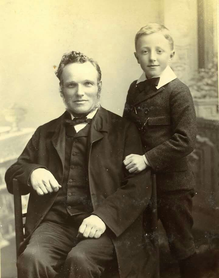 This is Edwin Baker and his youngest son George. Until 1896 when he emigrated to America, he was Hailshams main photographer. The majority of the street scenes we have of this period are down to him. He was extremely well thought of and when he left the town the Hailsham residents clubbed together and presented him with an album with signatures etc of his old friends and acquaintances.