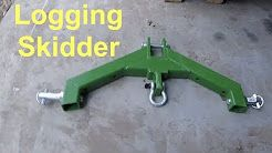 CHECK OUT THE DETAILS ON THIS GREAT SKIDDING ATTACHMENT>