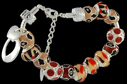 silver plated items: bracelet with lobster, enamel beads, glittering beads, double-heart charm, locks. Five glass beads with 925 silver core.