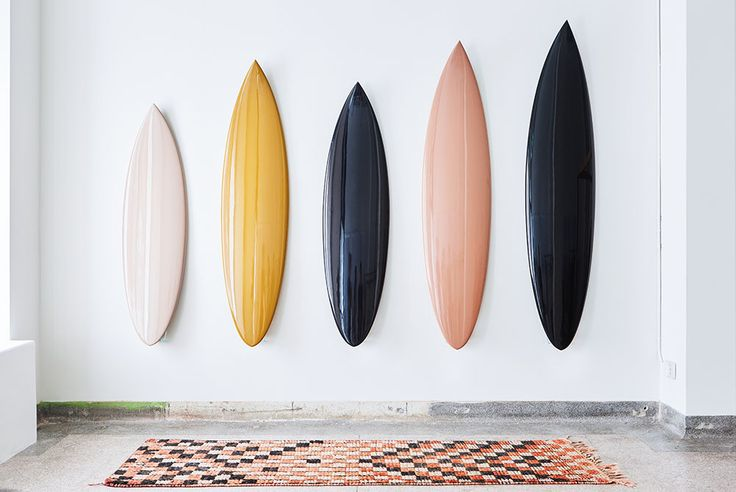 Custom BRITT MERRICK FOR H. MERRICK surfboards are a collaboration between brother and sister and are crafted in the colors of Merrick's fall collection— nude, saffron, black and blush.