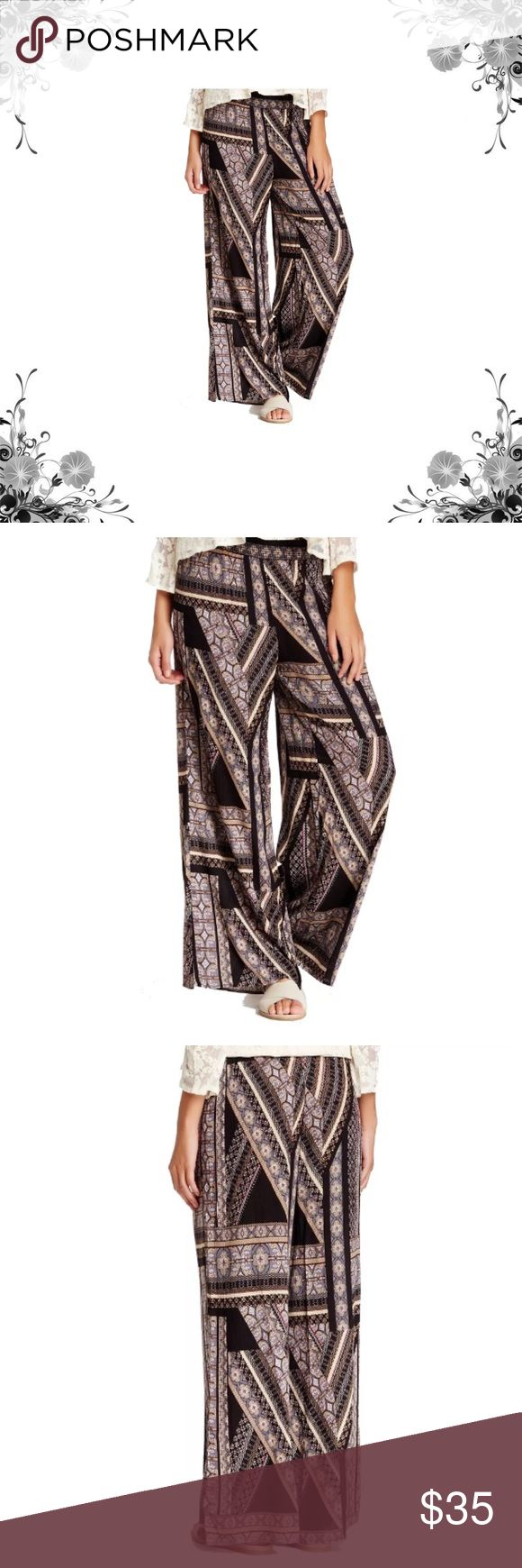 ASTR Printed Palazzo Pants Casual pants. Rayon. A mixed-pattern palazzo pant made from airy rayon fabric in a breezy, wide leg silhouette. Smocked waist. Allover print. Wide leg. Bundle for discounts! Thank you for shopping my closet! ASTR Pants Wide Leg
