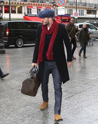 Want to go more subtle? Pair a long overcoat, plain sweater, and jeans with a thick red scarf.