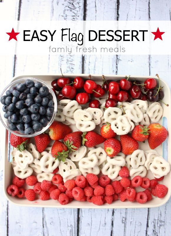 Easy Flag Fruit Dessert is made with cherries, strawberries, blueberries and chocolate-covered pretzels, patriotism never tasted so good.