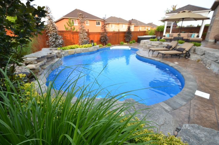 Doesn't this swimming pool look inviting? A gorgeous pool area to spend your summer days in!