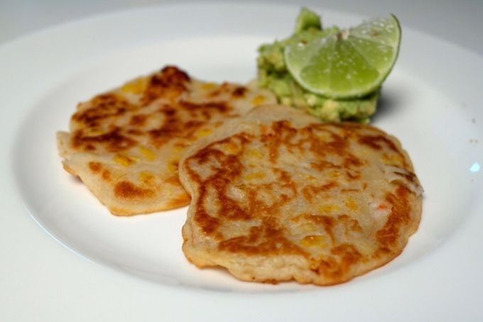 Shrimp corn pancakes made with coconut milk and served with Guacamole - FoodFamily.net