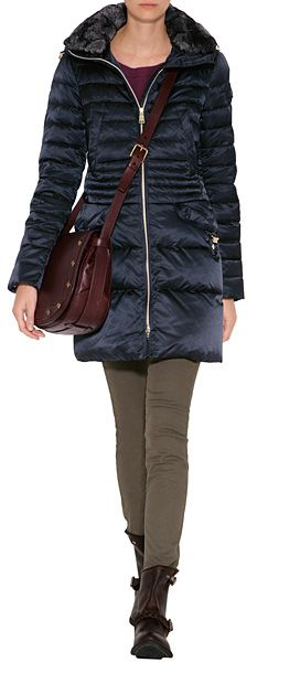 Chic quilting and a luxe fur collar lend a dressy look to this tailored parka from Peuterey #Stylebop