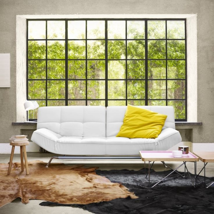 The Smala settee favoured for it practical but modern style. Designed by Pascal Mourgue in 2000 it a mainstay in the collection. Its multi-positioning back rests and armrests make it highly functional.