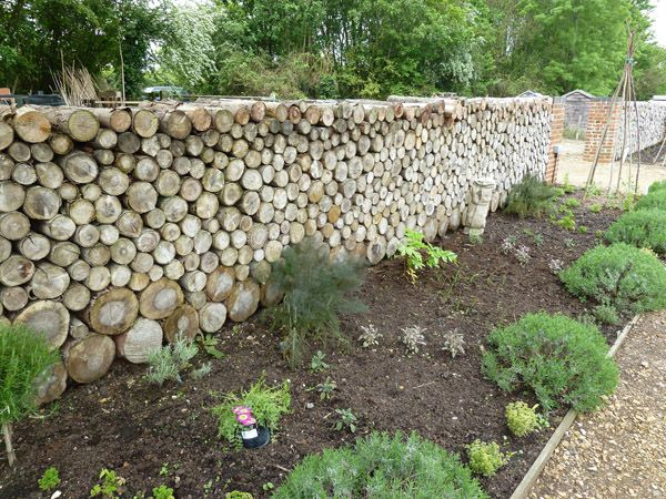 The log wall another stealable idea garden ideas pinterest log wall gardens and garden - Garden log decorations ...