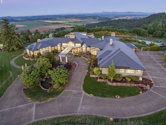 For sale: $4,500,000. Distinctive 50ac hilltop view estate w/luxurious amenities! Chef's kitchen w/4 islands, griddle/gas/electric/bbq cooktops, duel ovens, Butler's pantry. Maple flrs & Cherry cabinets thruout. Master w/theater, office, yoga, bar, huge his/her closet, spa bath. Game rm w/bowling alley, wet bar, pool table, stone fire. Indoor pool w/retract roof, sport court, lrg workshop. Panaramic valley/mtn views. Manicured land...