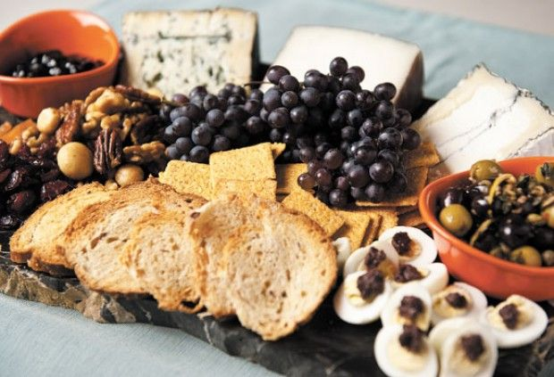 Accompany the Cheese with Fruit , nut breads, unflavored crackers, thin slices of French, white or wheat bread Dried dates, raisins, figs, apricots, fresh seasonal fruits: grapes, pears, nuts:pecans, almonds and hazelnuts, olives and cured meats.