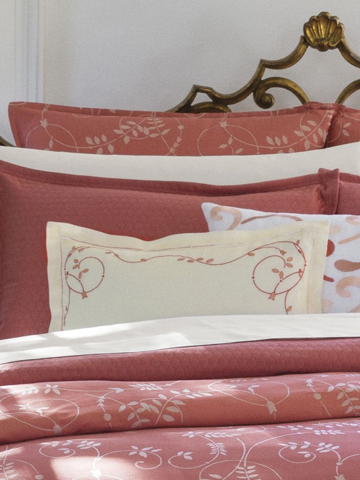 Delicate vines and romantic flower embroidery provide a perfectly pretty decorative accent for any room this spring.