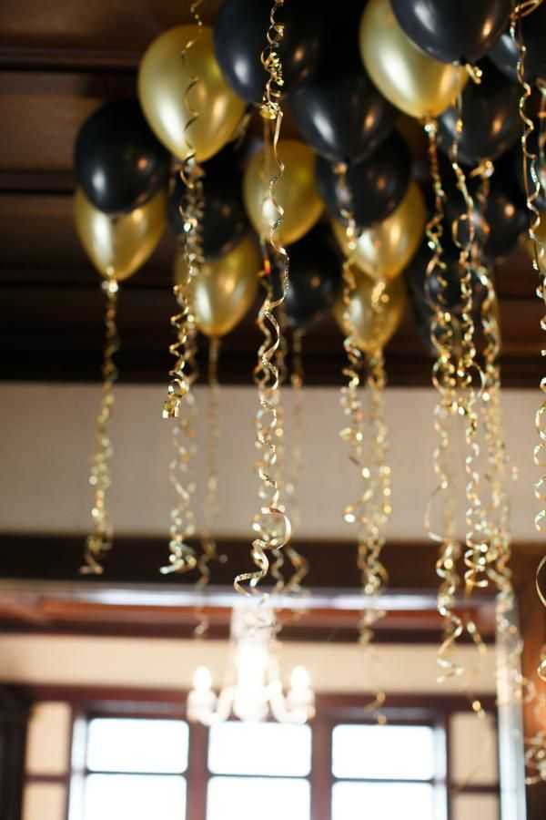 8 incredible new years eve party decoration ideas black and gold balloons with gold ribbon - Decorations Ideas