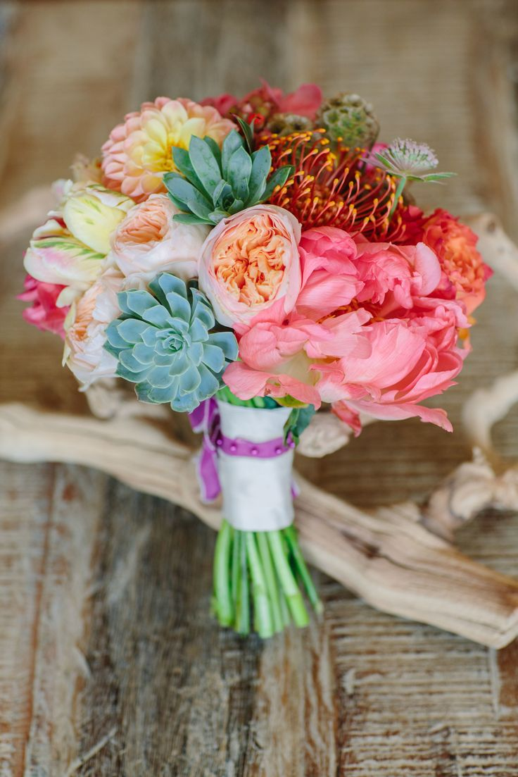 Coral Charm Peony + Succulent bouquet from isariflowerstudio.com | Read More: http://www.stylemepretty.com/little-black-book-blog/2014/06/12/rustic-la-jolla-wedding-full-of-charm/ | Photography: Joielala Photographie - joielala.com