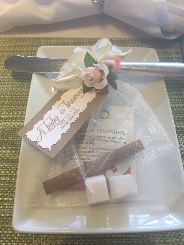 A baby is brewing baby shower favors filled with English black tea, cinnamon stick, sugar cubes.