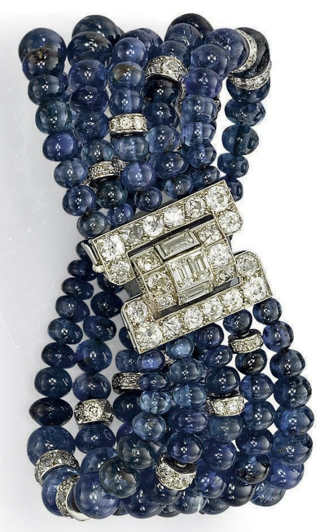 AN ART DECO SAPPHIRE AND DIAMOND BRACELET, BY CARTIER. The five rows of graduated sapphire beads enhanced by diamond-set rondelles, to the vari-cut diamond buckle clasp, 1930s, with French assay mark for platinum. Signed Cartier Paris, and numbered. #Cartier #ArtDeco #bracelet