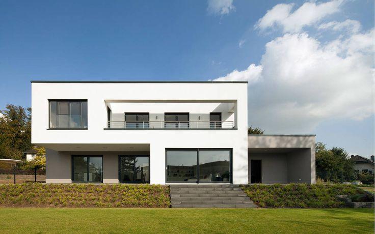 Gartenansicht : Minimalistische Häuser von Skandella Architektur Innenarchitektur