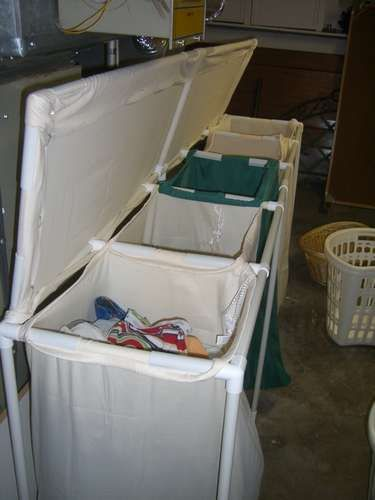DIY laundry bin!!! Much cheaper than those million dollar ones that only hold two or three laundry bags..