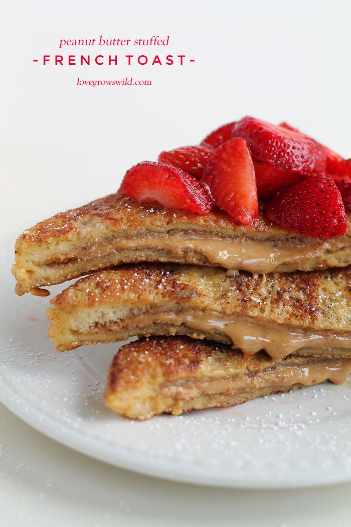 A decadent french toast recipe stuffed with creamy peanut butter and topped with fresh strawberries! This is one amazing breakfast! | LoveGr...
