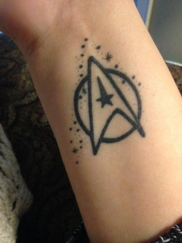 Star Trek commander symbol with Pisces constellation | Source: Lindsey, inked by Carlo at Sinister Skin