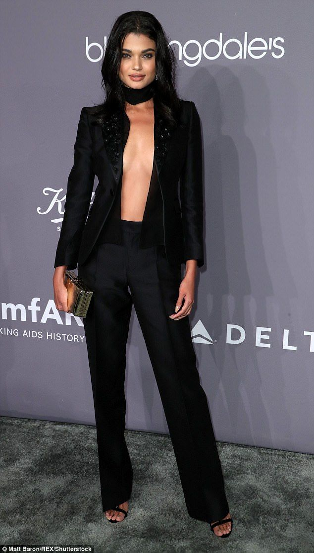 Bold fashion statement: Brazilian model Daniela Braga put on a daring display as she arriv...