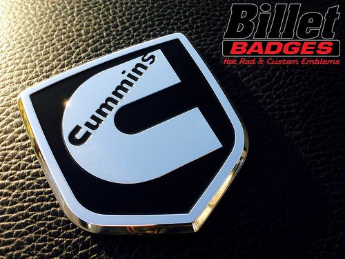 "This Cummins ""C""  '09- '12 Dodge Grille Shield is polished with gloss black background paint fill. For more info visit www.billetbadges.com.  #billetbadges #Dodge #cummins #truck #emblem #custom #madeinusa"