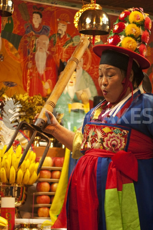 Priestess performs a shamanic ritual in the harbor city of #Incheon, Korea