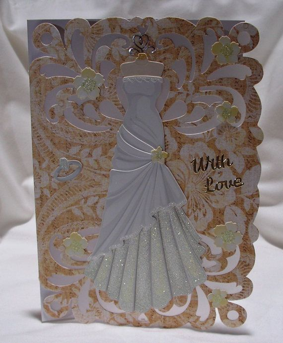 Cards are better to get in the mail than bills. And you might just make someones day with this one. She will have everything she needs with this card; the dress sand lots of love. A peek-a-boo taupe behind white vellum. The dress is gorgeous and front and center in the card. In foil a the left of the card says with love. Little flowers with glitter in the center    The card is about 5 x 7 and is blank inside so you can customize the perfect message for your special someone.    Comes with…